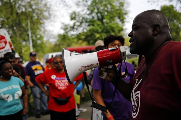 Jitu Brown, with the Kenwood Oakland Community Organziation and also with the local school council at Dyett High School, speaks to protesters who marched from Overton Elementary School to Dyett High School in Chicago on Sunday.