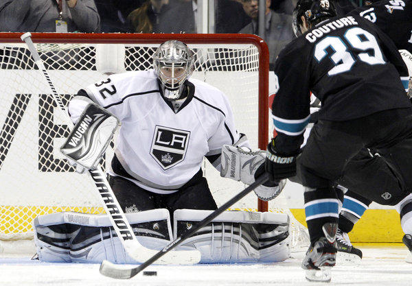 Kings goaltender Jonathan Quick (32) is unable to block a shot off the stick of San Jose Sharks' Logan Couture (39) in overtime.