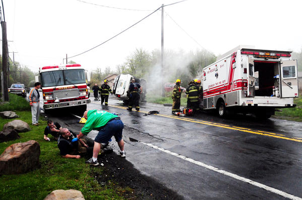 Crews work to extricate victims from a Monroe County crash that killed a Stroudsburg man and injured four Coolbaugh Township volunteer firefighters. Officials said a taxi crossed into the path of a Coolbaugh Township emergency vehicle on State Route 196.