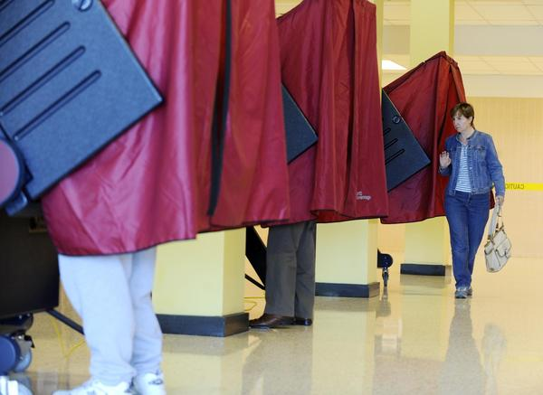 At Bethlehem Area Vocational and Technical School voter Monica Wagner of Bethlehem Twp., right, leaves the voting booth. This if for Dan Sheehan story about voting in the suburbs of Northampton County on primary day.