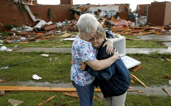 Jerry Dirks, at right, hugs her friend Earlene Langley after a tornado hit Dirks' home just south of Carney, Okla. Dirks was in her cellar.