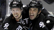 SAN JOSE — When Kings defenseman Drew Doughty had his day with the Stanley Cup last summer, he held a party in his hometown of London, Canada, and encouraged guests to pose for photos with the gleaming trophy. Logan Couture, Doughty's childhood pal and now a rival as a center for the San Jose Sharks, stayed behind the camera, deliberately beyond reach of the revered prize.