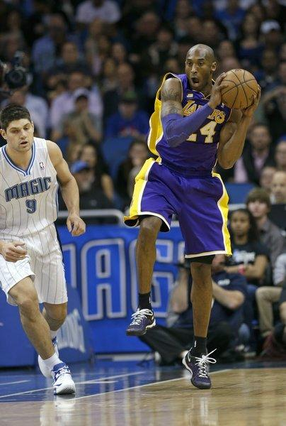 Lakers guard Kobe Bryant grabs a rebound against the Orlando Magic.