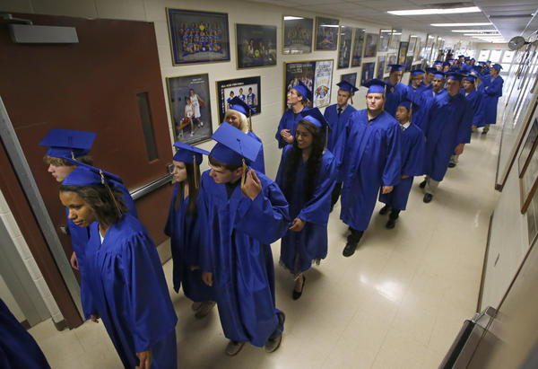 Graduates make their way to the Golden Eagles Arena as the processional began for Sunday's commencement exercises at Aberdeen Central High School.