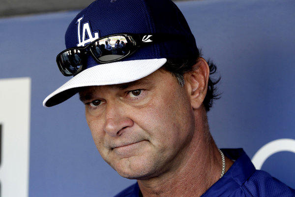 Los Angeles Dodgers Manager Don Mattingly talks with reporters before a game against the Miami Marlins.