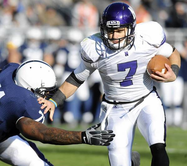 Former Liberty High quarterback Dan Persa, here scoring a touchdown for Northwestern against Penn State in 2010, works in Chicago but still returns to the Lehigh Valley to help out upcoming players at football camps.