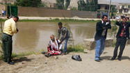 POL-E-KHOMRI, Afghanistan (Reuters) - A suicide bomber blew up a senior official and 14 others outside a government office in the northern Afghan province of Baghlan on Monday, police said.