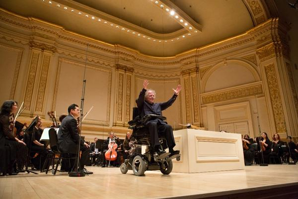 Conductor James Levine, with members of the Metropolitan Opera orchestra, at a concert at Carnegie Hall in New York.
