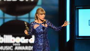 Taylor Swift reina en los premios Billboard