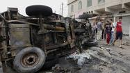 A string of car bombs and shootings tore through Shiite and Sunni areas of Iraq on Monday, killing at least 57 people and escalating fears of a return to widespread sectarian bloodletting, officials said