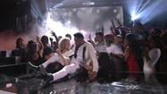Singer Miguel lands on top of fan at Billboard Music Awards
