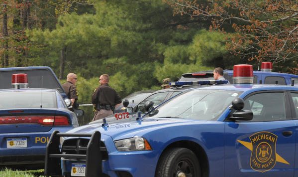 The Michigan State Police, Charlevoix County Sheriff's Department and Boyne City Police Department set up a tactical operations center across from Boyne Fall Public Schools on Friday to search for what a witness called a man brandishing a handgun.