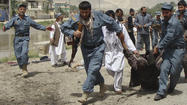 KABUL, Afghanistan -- A suicide bomb blast killed a top leader of a northern Afghan province and at least 12 other people Monday, the latest in a step-up of attacks by Taliban insurgents ahead of Washington's planned troop withdrawal at the end of 2014.