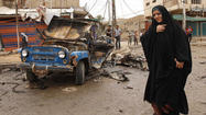 BAGHDAD -- Car bombs around Iraq killed at least 65 people Monday as the country's worst wave of violence since U.S. troops withdrew a year and a half ago continued.