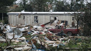 Debris is seen at a mobile home park which was destroyed by a tornado on Sunday, west of Shawnee, Oklahoma