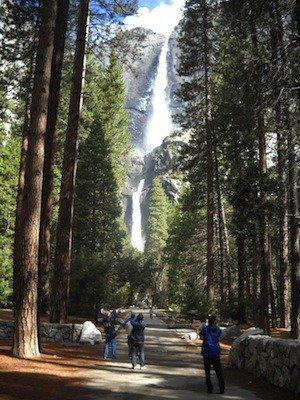 Tourists snap photos of Yosemite Falls last month. Despite the water works, the park is experiencing higher than usual fire danger for this time of year.