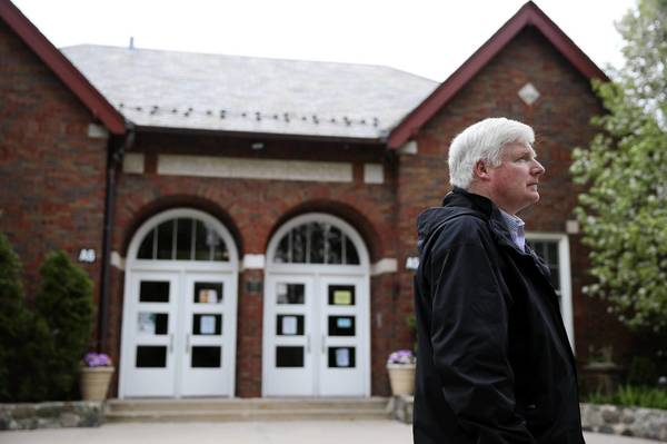John Fay walks by Winnetka's Hubbard Woods School, site of the Laurie Dann shootings, Fay, then a paramedic, was among the first responders.