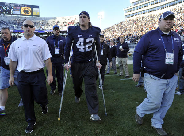 Penn State's Michael Mauti leaves the field on crutches after an injury against Indiana at Beaver Stadium on Saturday, November 17, 2012, in State College, Pennsylvania. (Christopher Weddle/Centre Daily Times/MCT) ** HOY OUT, TCN OUT **