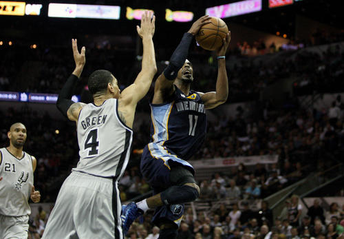 Memphis Grizzlies point guard Mike Conley (11) drives to the basket during the third quarter as San Antonio Spurs shooting guard Danny Green (4) defends in game one of the Western Conference finals of the 2013 NBA Playoffs at AT&T Center.