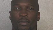 Former Miami Dolphins wide receiver Chad Johnson was jailed briefly Monday after he was accused of violating his probation on a domestic violence charge.