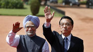 NEW DELHI – The Indian and Chinese premiers papered over their differences at a meeting in New Delhi on Monday, pledging to tackle a border dispute that has soured relations for decades and to work together for global stability.
