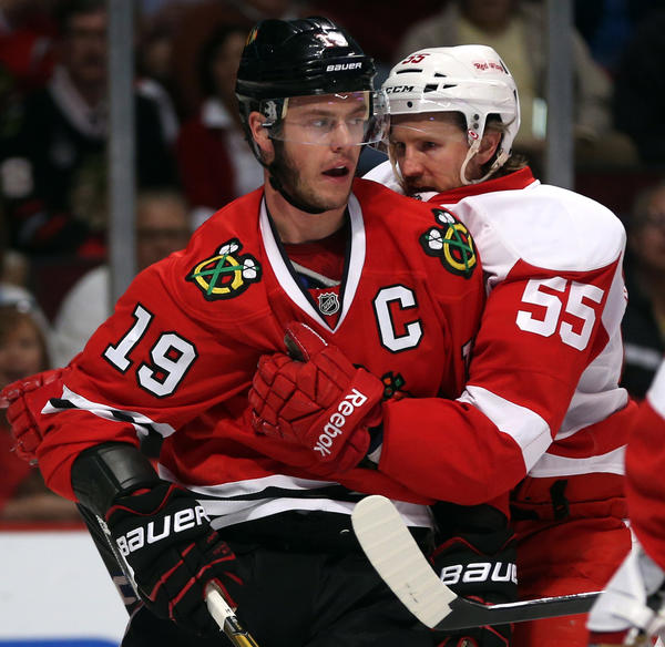Detroit Red Wings defenseman Niklas Kronwall grabs the jersey of Blackhawks center Jonathan Toews during Game 2.