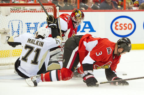 Pittsburgh Penguins centre Evgeni Malkin (71) is knocked into the Ottawa Senators goal by defenseman Marc Methot (3) in the first period in game three of the second round of the 2013 Stanley Cup playoffs at Scotiabank Place.