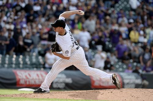 Colorado Rockies relief pitcher Rafael Betancourt (63) delivers a pitch in the ninth inning against the San Francisco Giants at Coors Field. The Rockies defeated the Giants 5-0.