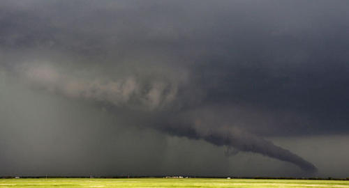The funnel of a tornadic thunderstorm almost touches the ground near South Haven, in Kansas May 19, 2013. A massive storm front swept north through the central United States on Sunday, hammering the region with fist-sized hail, blinding rain and tornadoes, including a half-mile wide twister that struck near Oklahoma City.