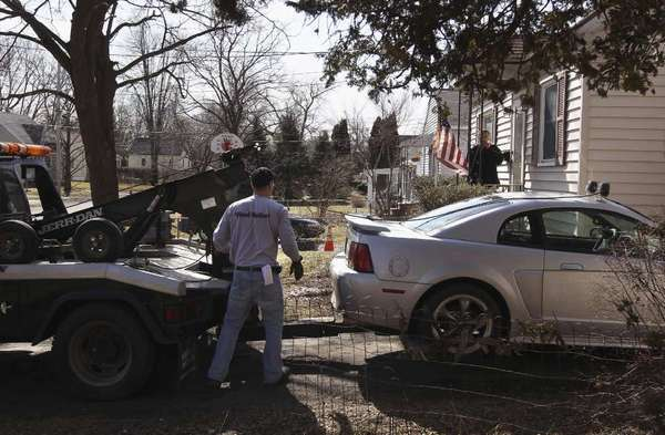 Jeff Grevelding prepares to tow a vehicle in Syracuse, N.Y., last year after its owner allegedly fell behind in loan payments.