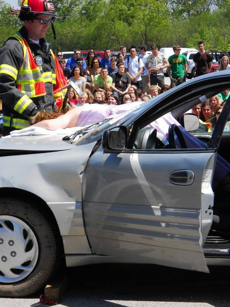 "Lake Zurich High School senior Erika Smolyar, 18, plays the role of a teen killed in a deadly car crash during ""Operation Prom Night,"" a simulated accident intended to deter teens from driving under the influence."