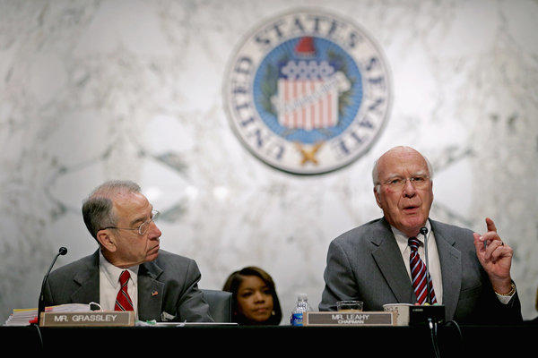 Sen. Patrick J. Leahy (D-Vt.) makes a point during a committee hearing on immigration reform. At left is Sen. Charles E. Grassley (R-Iowa).