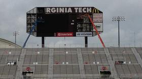 PHOTOS: Lane Stadium scoreboard being torn down