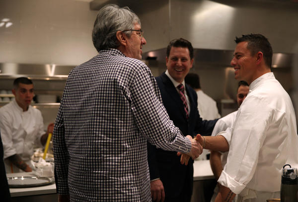 General Manager/Partner Michael Muser, center, and Chef Curtis Duffy, right, give a tour of the kitchen to Cliff Colnot, a regular patron since Duffy's days in Avenues, during opening night at Grace restaurant, December 11, 2012.