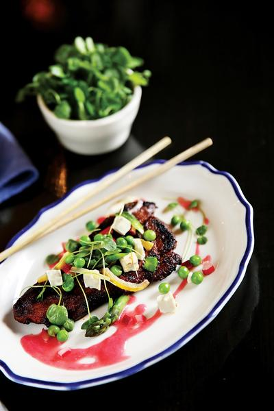 Fat Rice grilled vindaloo spring lamb shoulder chops with spring salad and rhubarb chutney.