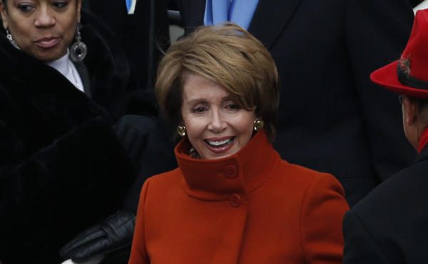 Nancy Pelosi arrives for the ceremonial inauguration of President Barack Obama at the Capitol.