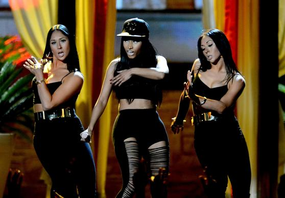 Nicki Minaj, center, performs onstage during the 2013 Billboard Music Awards.
