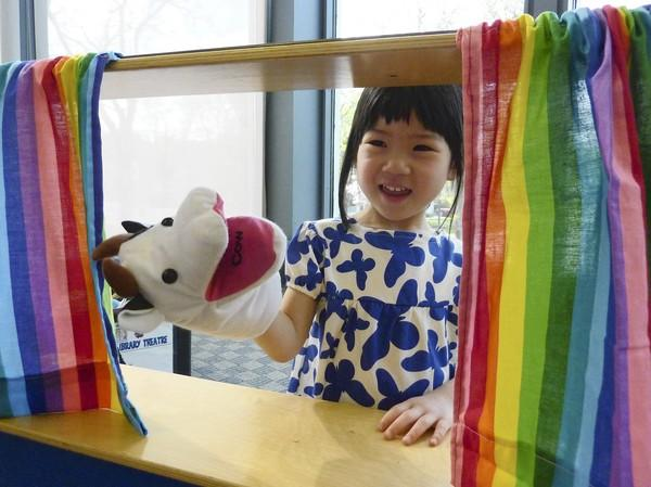 Amy Yoon, 3, plays with puppets at the Northbrook Public Library on May 15. In the library's revamped game-day program, she will learn to experiment with scientific projects using constructive toys that the library is collecting.