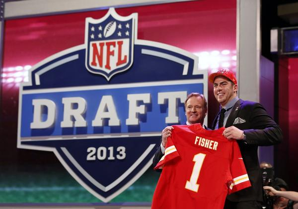 Eric Fisher (right) from Central Michigan University stands with NFL Commissioner Roger Goodell after being selected by the Kansas City Chiefs as the first overall pick in the 2013 NFL draft.