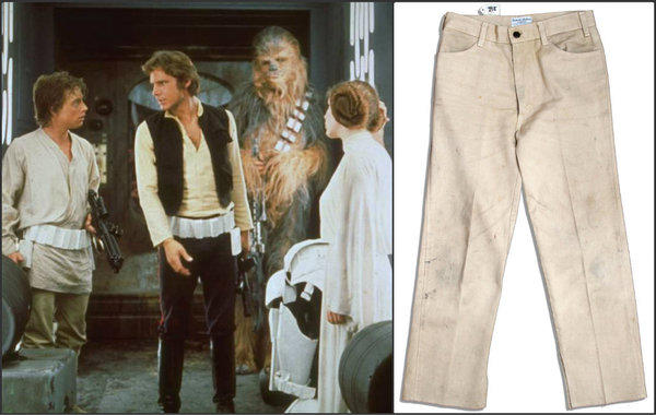 "Mark Hamill, left, Harrison Ford, Peter Mayhew and Carrie Fisher in a scene from ""Star Wars."" At right, a pair of pants, worn by Hamill in the 1977 film, is up for auction."