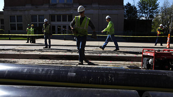 Peoples Gas workers install a new 18 inch valve medium pressure header main on the 5200 block of W. Grace in Chicago last month.