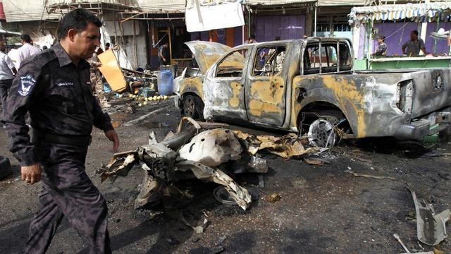 Headline: Latest wave of car bombings in Iraq kills at least 65