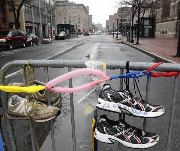 Sneakers hang on gate in memory of the Boston Marathon bombing in Boston, Massachusetts.