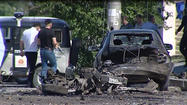 MOSCOW -- Twin explosions rocked the capital of Dagestan on Monday, killing four people and injuring dozens in the Russian region most recently known for its association with the Boston Marathon bombing suspects.