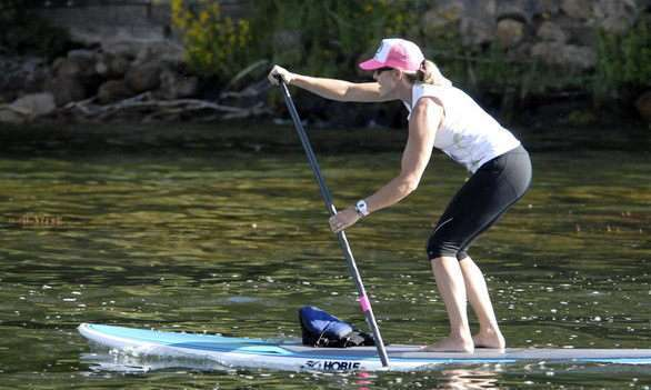 Paddleboarding on Big Bear Lake, where the cool mountain water offers a refreshing summer escape.