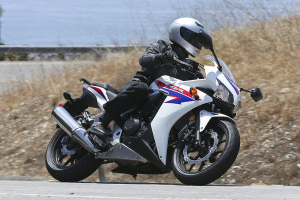 Putting the Honda CBR500R through its paces on a Palos Verdes twisty.