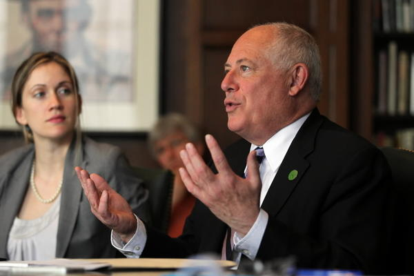 Gov. Pat Quinn talks to the Tribune editorial board on Monday. To the left is spokeswoman Brooke Anderson.
