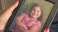 A 10-year-old girl who was killed Saturday night appears to have been watching TV inside the family home when she was shot.