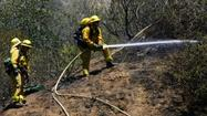 Firefighters on Monday were able to knock down a 1-acre brush fire that at one point was estimated at 20 acres above DeBell Golf Club.