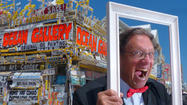 "All summer long, even on the hottest days, a gentleman in a tuxedo stands on the <a href=""http://www.baltimoresun.com/travel/beaches/"">Ocean City</a> boardwalk. Locals and vacationers scurry over to find out what he's up to."